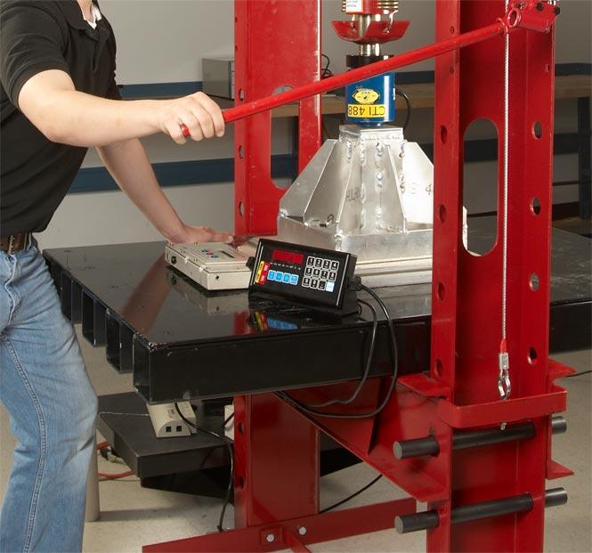 worker using a press machine